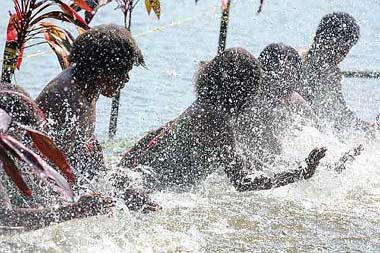 Riveting ripples: The Leweton Women from Vanuatu playing their water music in the lake.