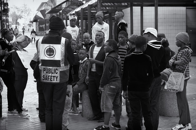 A public safety officer looks on as youths gather in St George's Mall Cape Town