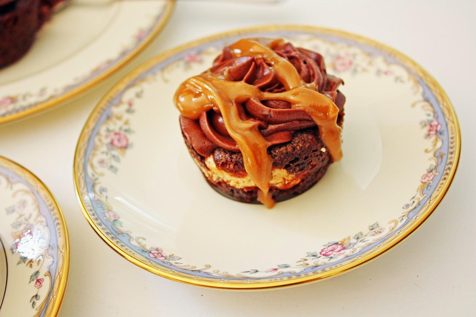 Cheesecake-stuffed mocha zucchini cupcakes with mocha frosting and peanut butter glaze