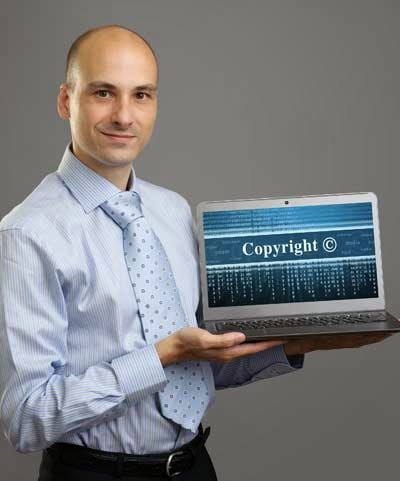 Man with computer copyrighted music downloads