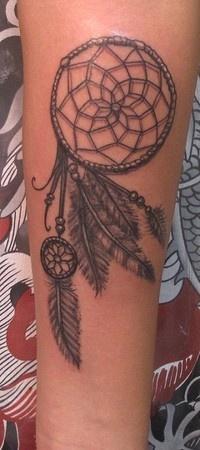 Dream catcher design tattoo on leg
