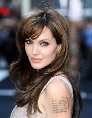 Джоли вече има татуировки на родните места на шестте си деца