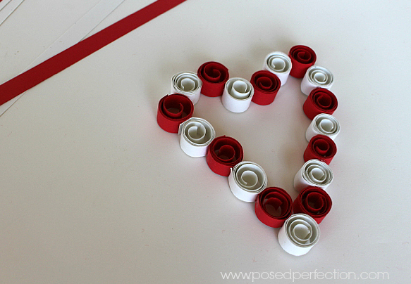 Want a fun craft to use up those paper scraps? This Rolled Paper Strip Heart couldn't be easier or cheaper to make!