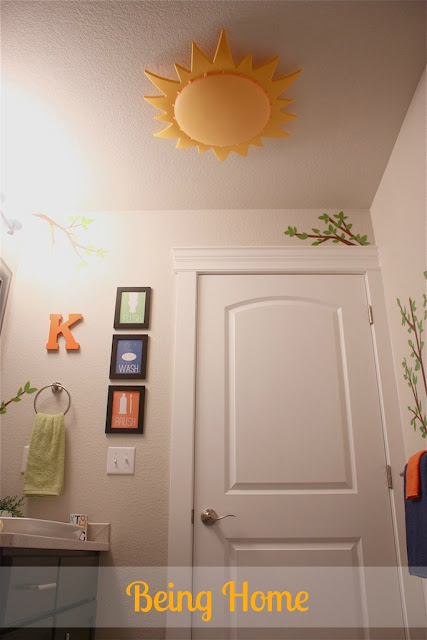 Boys Bathroom Makeover - After (tree decals and Ikea Smila Sol light)