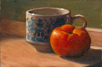 Oil painting of a willow pattern teacup and a red tomato on a chopping board with long afternoon shadows.