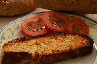 Grilled slice of fresh bread with some garlic butter