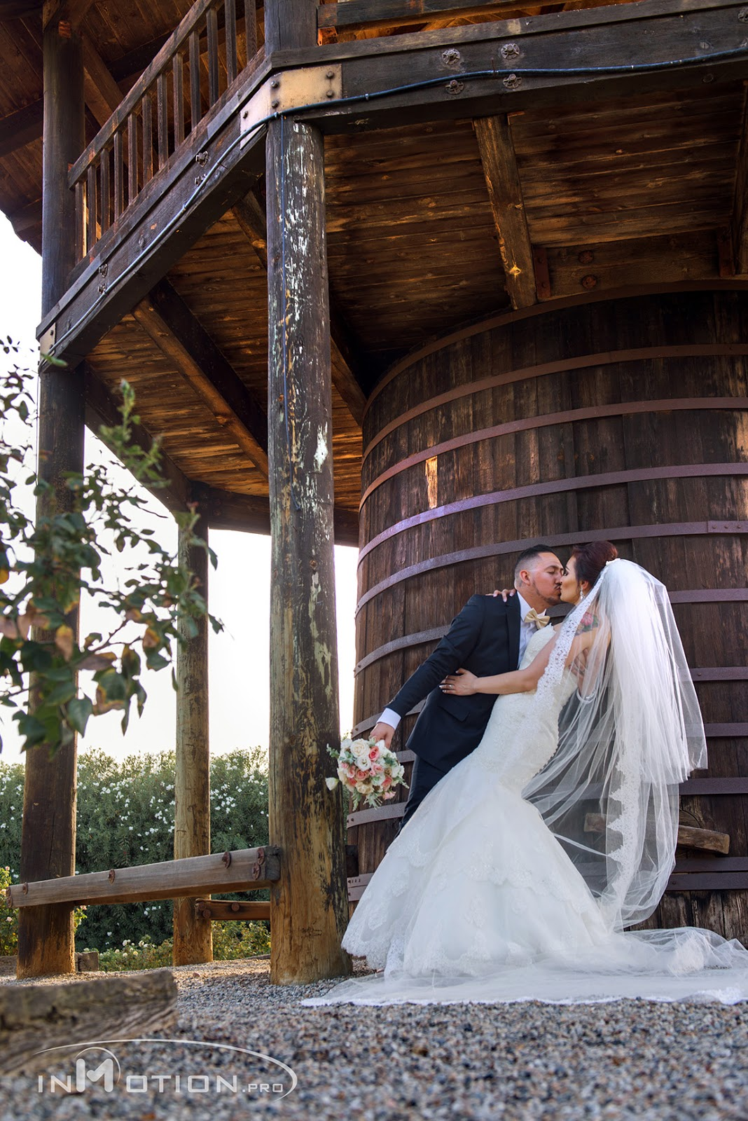 Water Tower Bride And Groom Portraits Kissing White Wedding Dress Photography