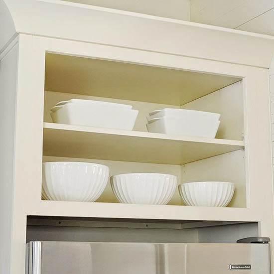 open shelving above refrigerator