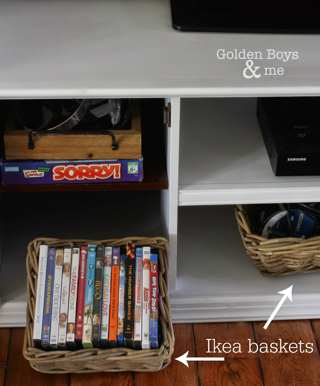 Ikea baskets to store movies and video games in family room-www.goldenboysandme.com