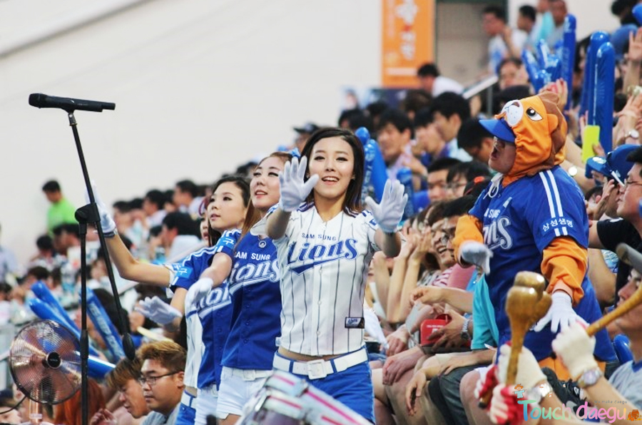 The cheerleaders and fans of Samsung Lions is watching the baseball game