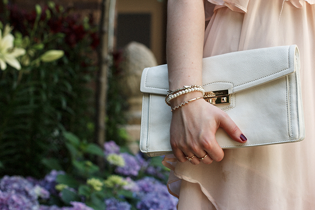 White Cole Haan clutch.