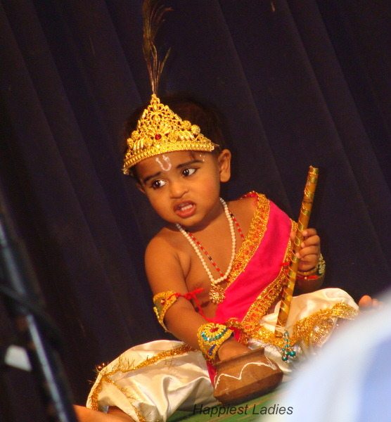Krishna digging hands into the butter pot