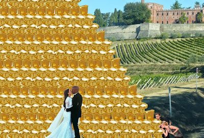 Kim Kardashian Kayne West wedding kiss golden toilet shower tower