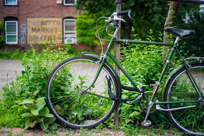 Portland, Maine USA July 2015 old green bicycle on South Street near Pleasant Street photo by Corey Templeton.