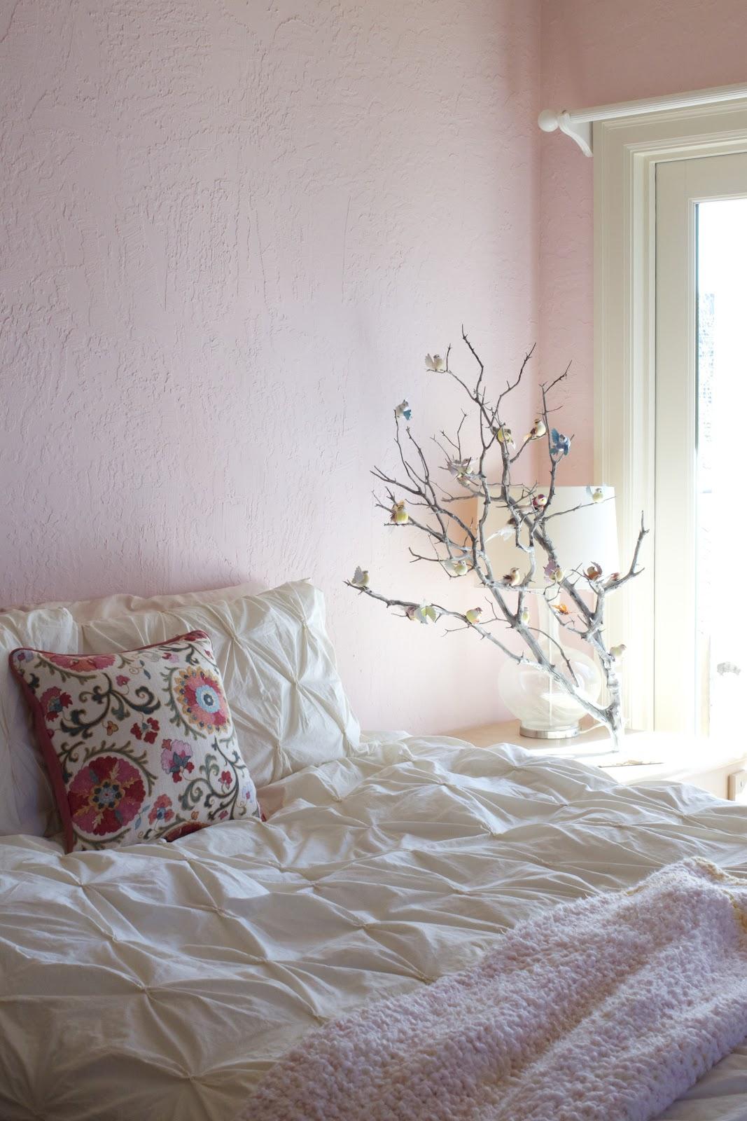 light pink bedroom walls or light pink blanket
