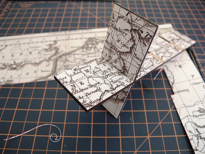 Dry-built modern dolls' house miniature laser-cut 'pidgeon' hole kit  covered in vintage map paper.