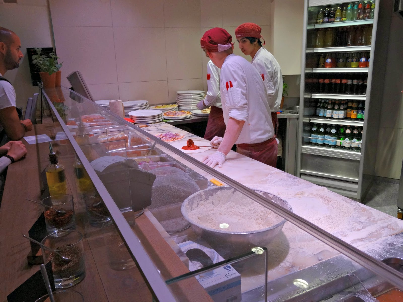 Vapiano chefs cooking fresh meals