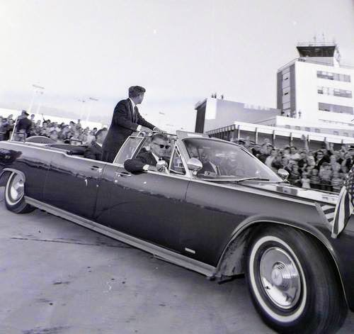 Kennedy's motorcade leaves the airport during a visit to Salt Lake City on September 26, 1963.