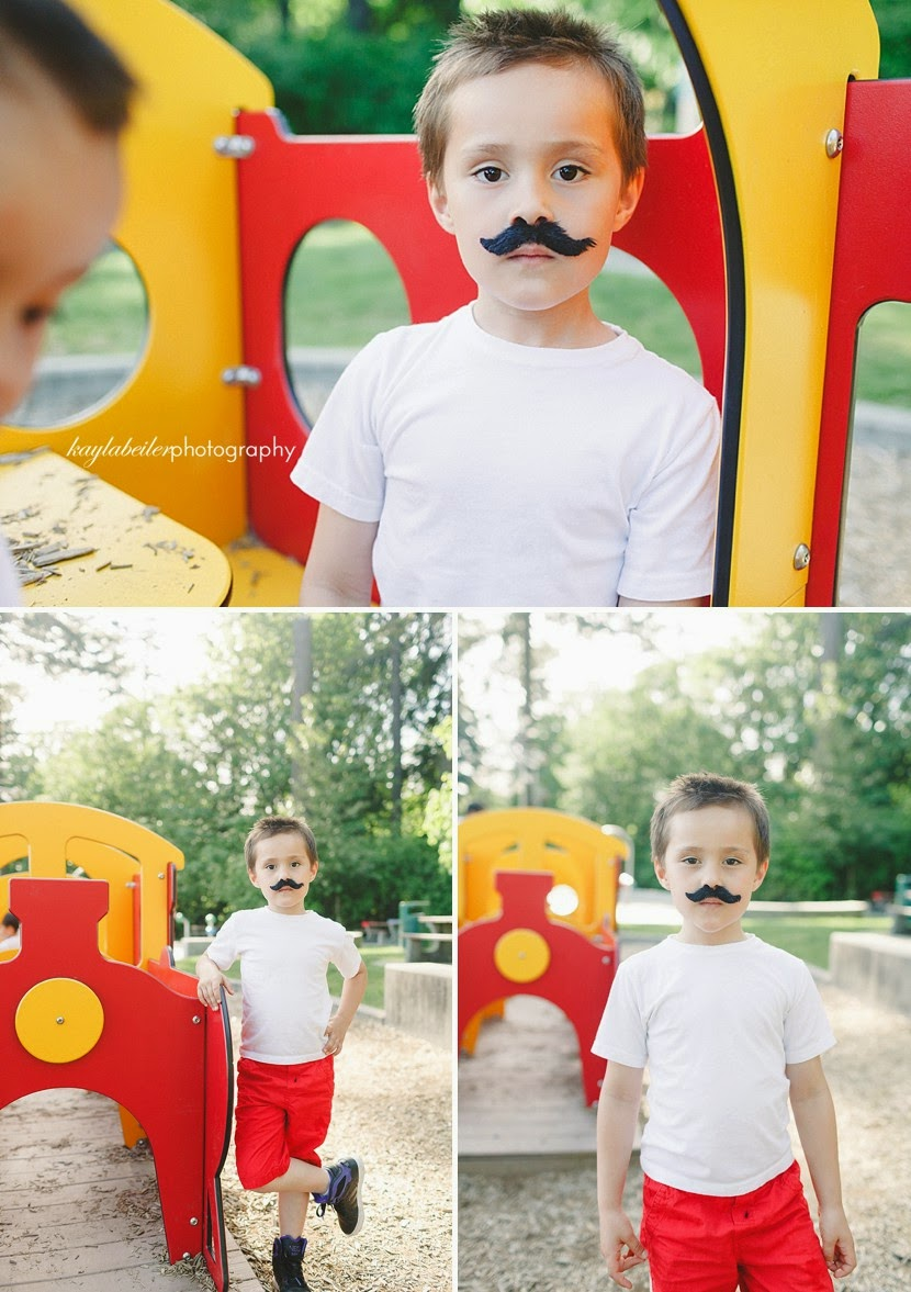 kids wearing mustache photo