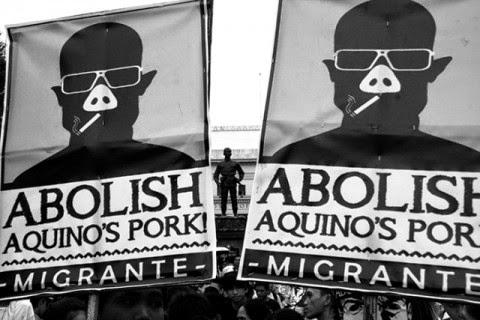 banners calling for abolishing pork barrel