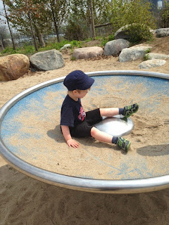 playground spinner, corktown common, toronto playground
