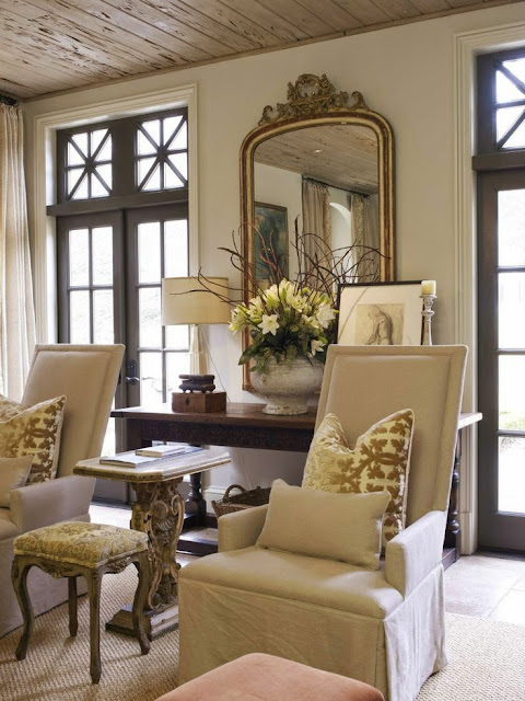 love thewood windows in this neutral cream traditional living room