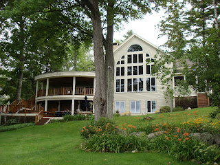this lake sunapee home features a large screened in porch, perfect for summer evenings