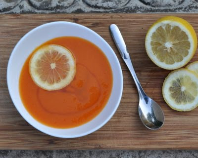 Chilled Carrot Soup with Honey, bright with spices and small kick of cayenne, sweetened w a drizzle of honey.
