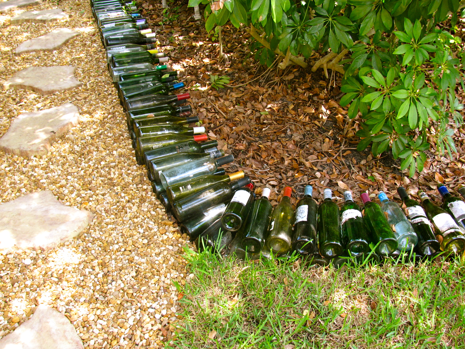 May days wine bottle garden border for How to use wine bottles in the garden