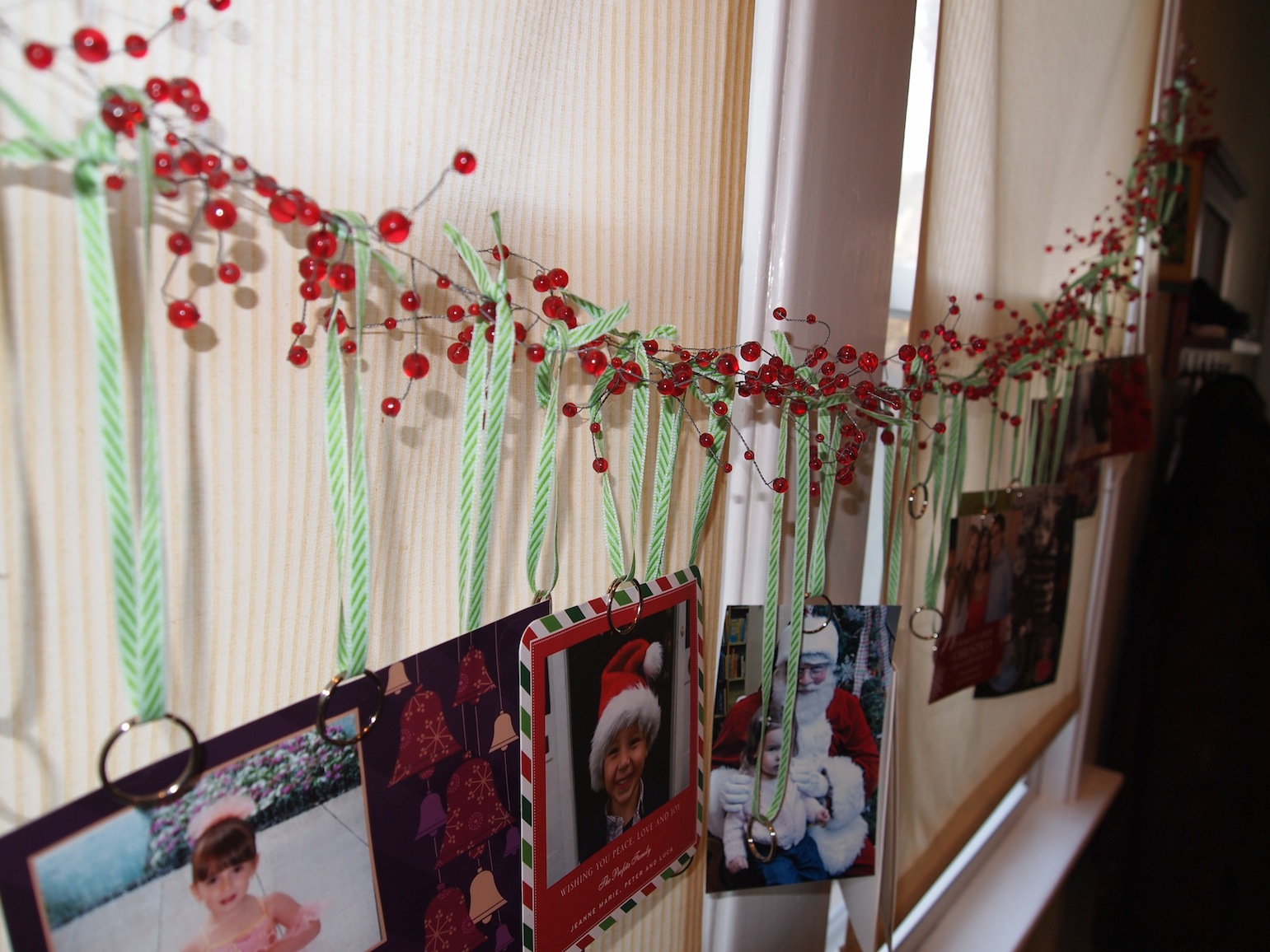 A Party Style Garland Christmas Card Display
