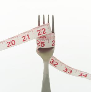 weight-loss-measuring-tape - How to Avoid Putting on Winter Weight