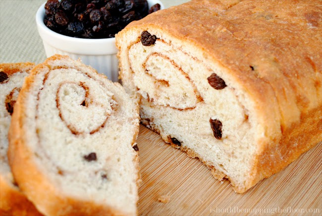 This Cinnamon Raisin Swirl Bread is filled with delicious buttery ribbons of cinnamon, sugar and California Raisins. | Makes three large loaves: perfect for freezing and gifting.