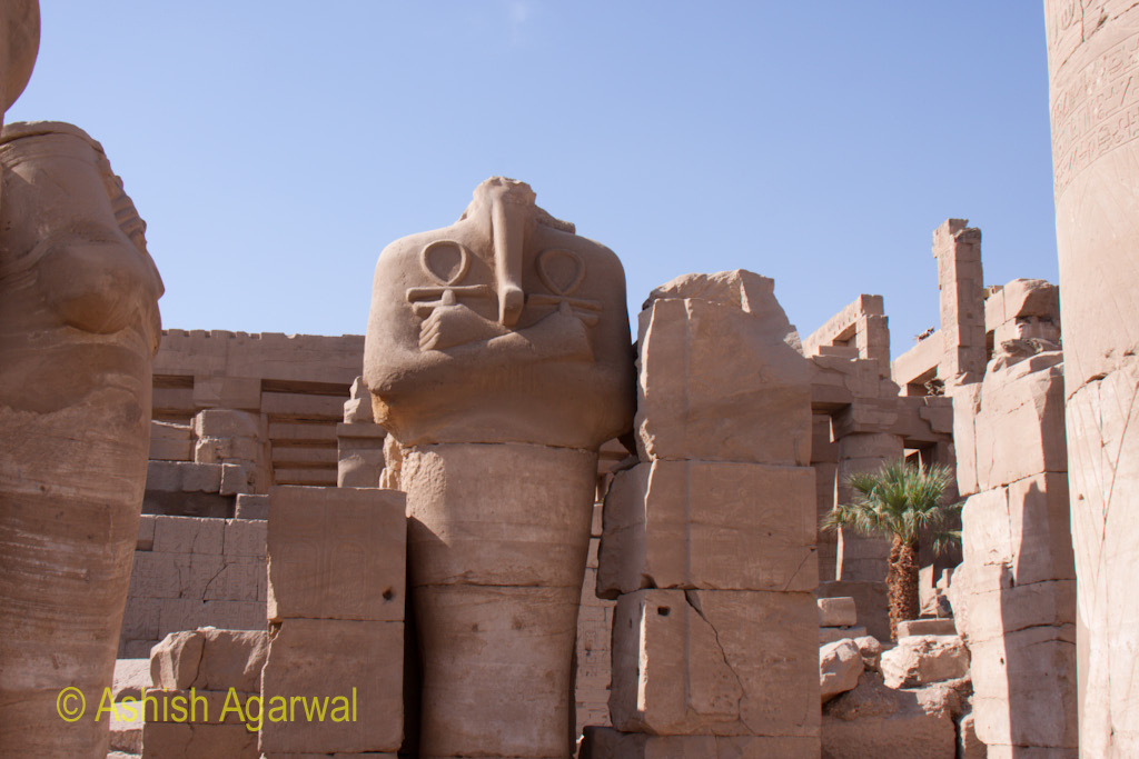Statue of a pharaoh, but without the head, inside the Karnak temple in Luxor