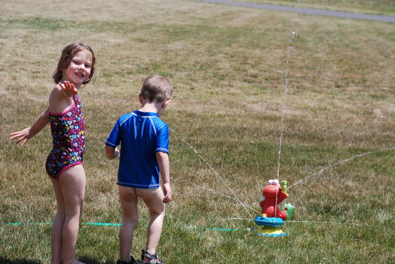 female child pee The kids had a blast in the sprinkler today!! We enjoyed being outside almost all day today!