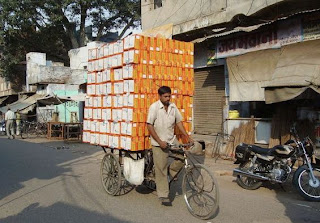 A ingenious man in India makes the best of his resources.