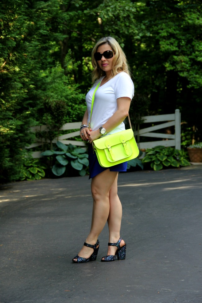 Blue Shorts - Zara, Basic T-Shirt - Forever 21, Oversized Round Check Sunglasses - Burberry, Neon Bag - Cambridge Satchel Company, Mid-Size Silver Color Golden Stainless Steel Camille Chronograph - Michael Kors, Bracelets - TJ Maxx