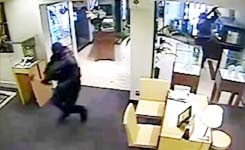 CCTV Shows Armed Robbers Storming Jewellers