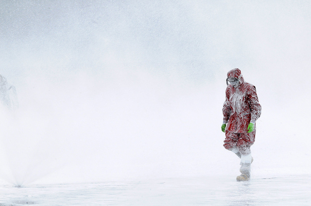 A man walking alone in a blizzard