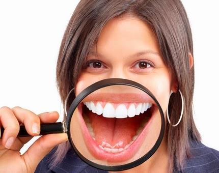 كيف تكتشفين أمراضك من خلال فمك
