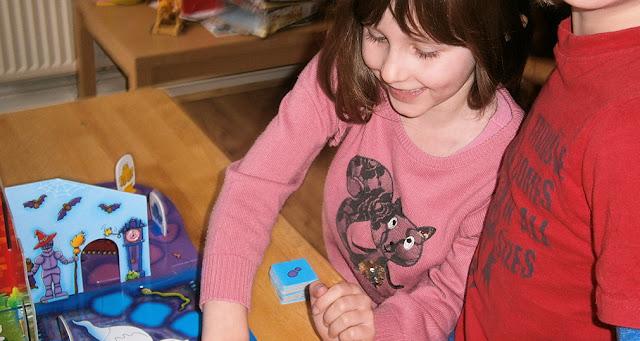 children playing board games