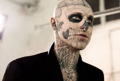 somediffrent skull face tattoo guy