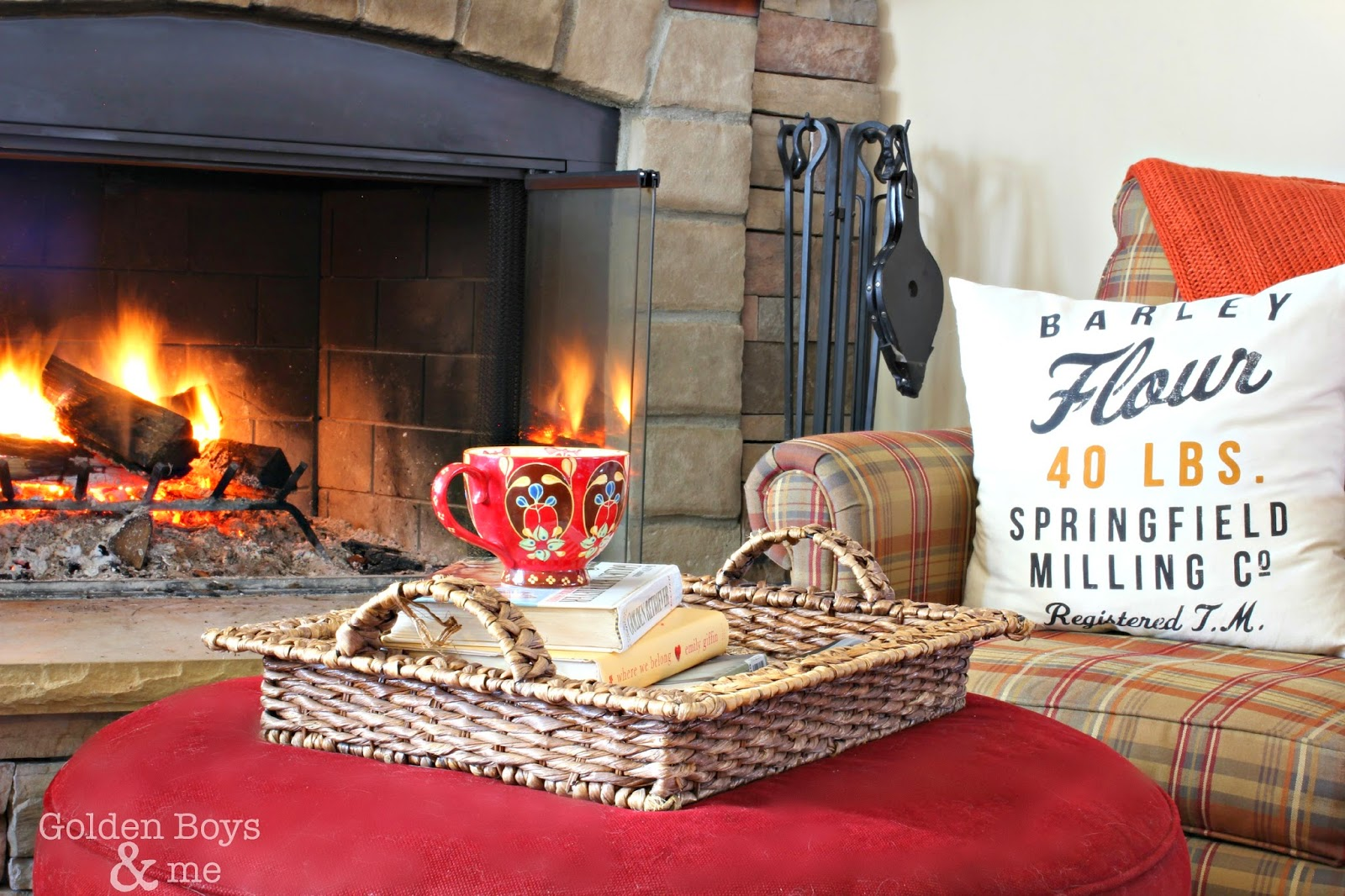 Basket on ottoman in front of fireplace-www.goldenboysandme.com