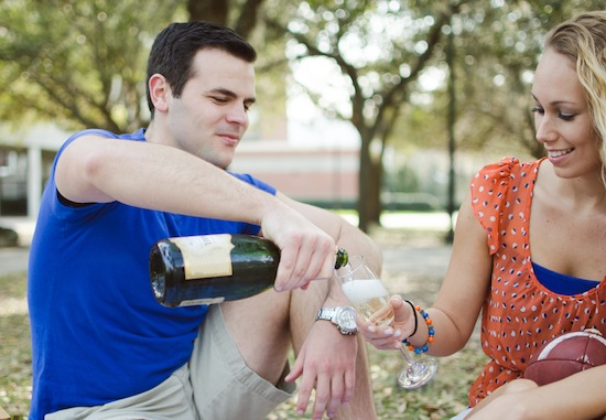 couple pouring champagne on their engagement session
