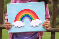 http://www.smilingcolors.com/2015/06/diy-nursery-wall-art-felt-rainbow-on-canvas/