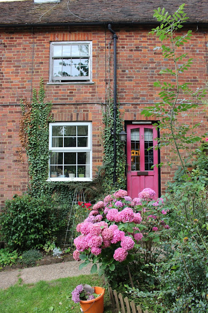 Pretty pink doors and hydrangeas in the countryside