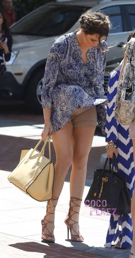 add your common sense: khloe kardashian's skirt get blown upwind