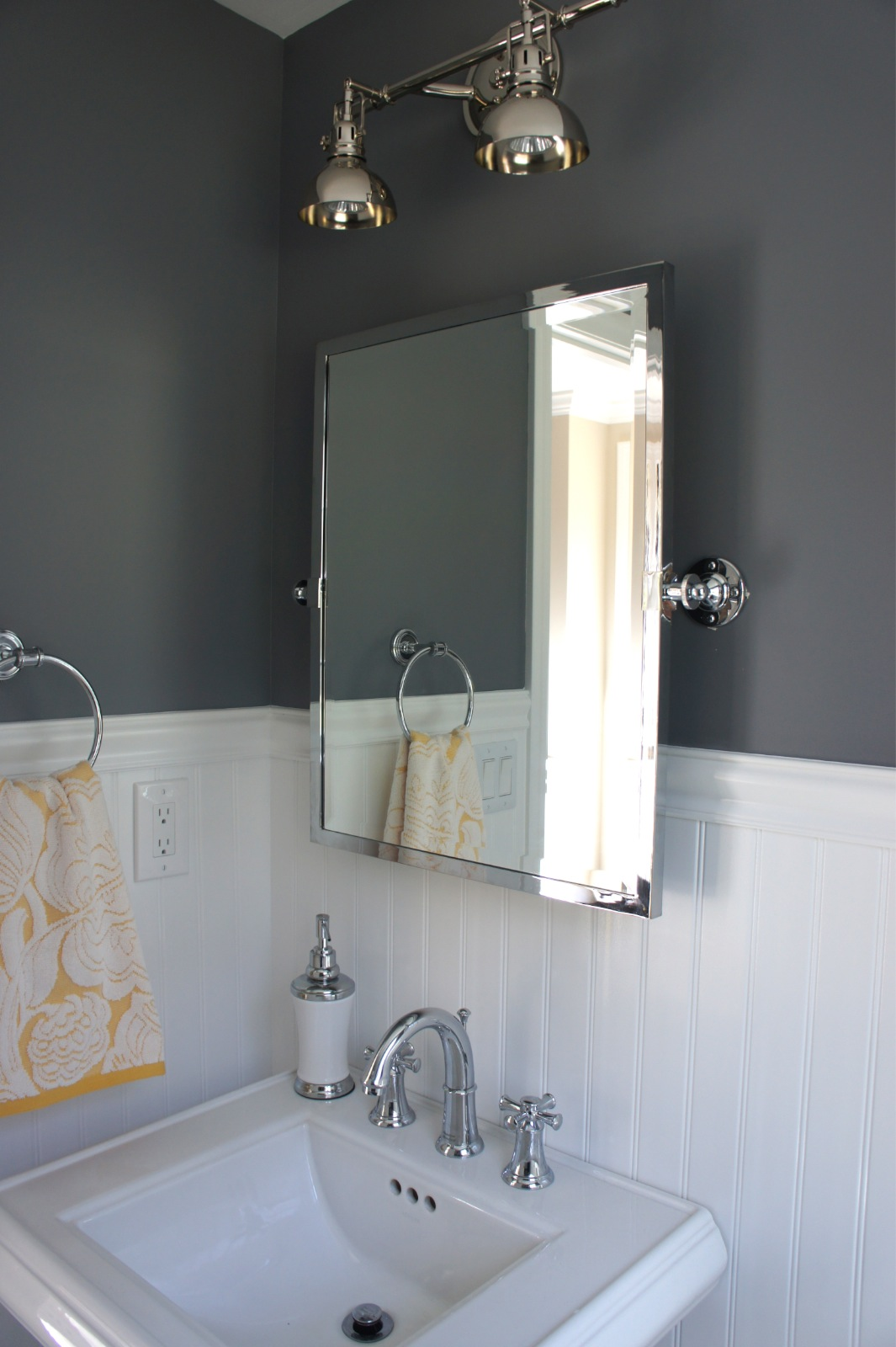 Home with baxter bathroom art and other updates for Bathroom lights above mirror