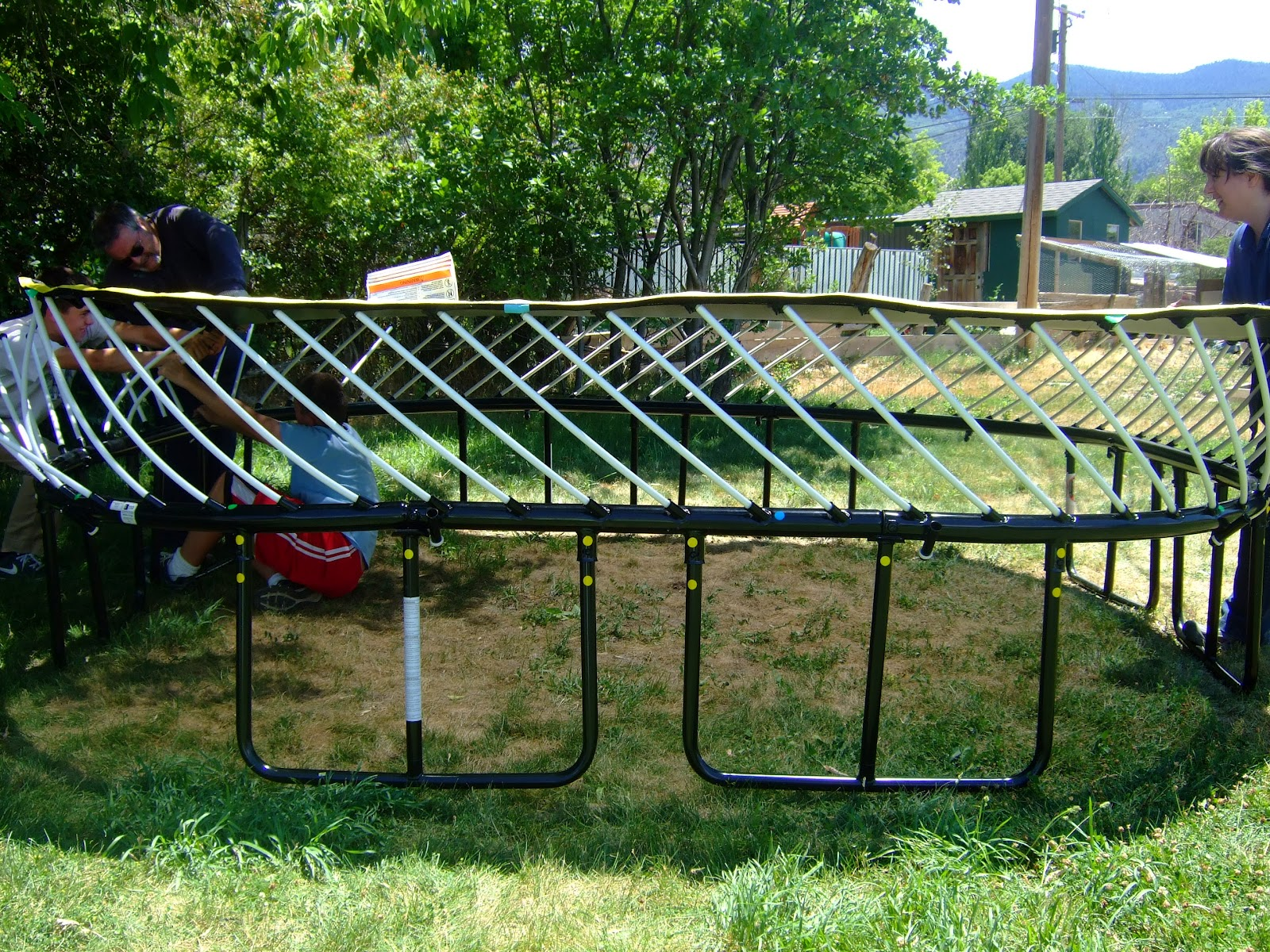 instructions on how to put a trampoline together