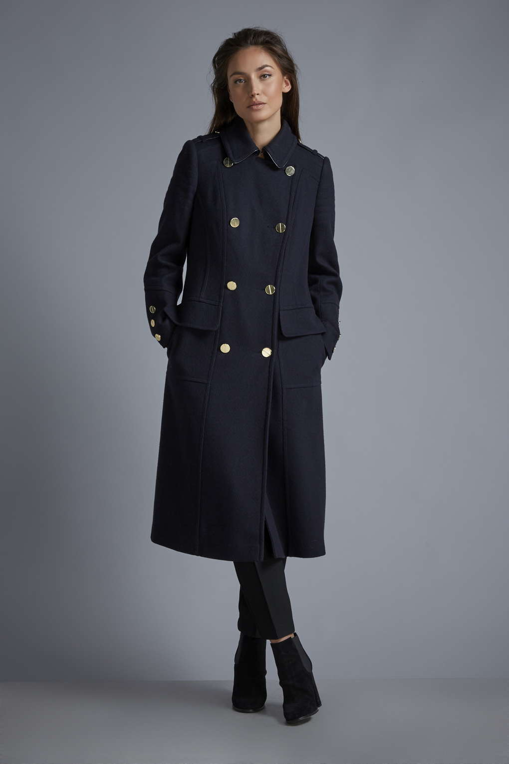 The jacket was design to be longer, to cover the backside, but short enough for the sailors to climb and move about. Unchanged for over years, the basic Navy peacoat has everything a person wants in a jacket: function, durability, and esthetics.