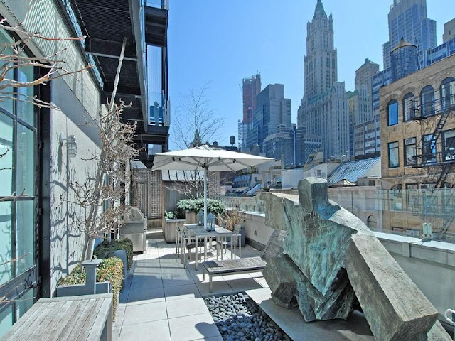 Photo of modern art sculpture and garden furniture on the rooftop terrace of Tribeca penthouse